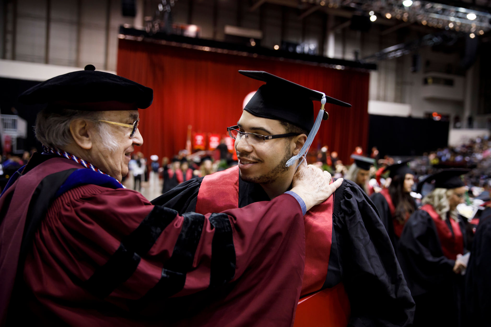 A graduate hugs a faculty member during the Indiana University Northwest Commencement at the Genesis Convention Center on Thursday, May 9, 2019. (James Brosher/Indiana University)