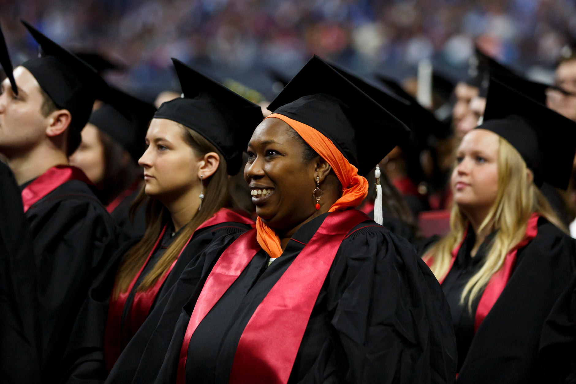 Graduates stand for the conferral of degrees during the IUPUI Commencement at Lucas Oil Stadium on Saturday, May 11, 2019. (James Brosher/Indiana University)