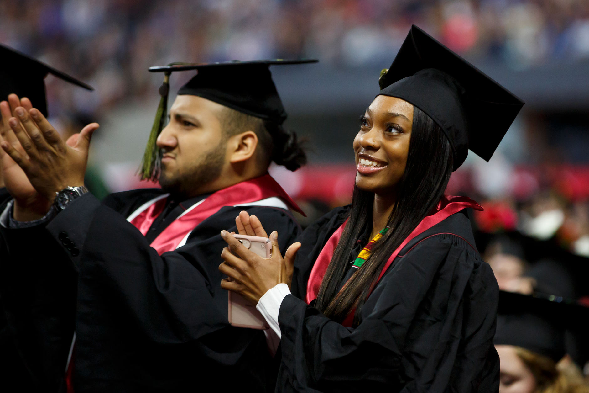 Graduates stand for recognition during the IUPUI Commencement at Lucas Oil Stadium on Saturday, May 11, 2019. (James Brosher/Indiana University)