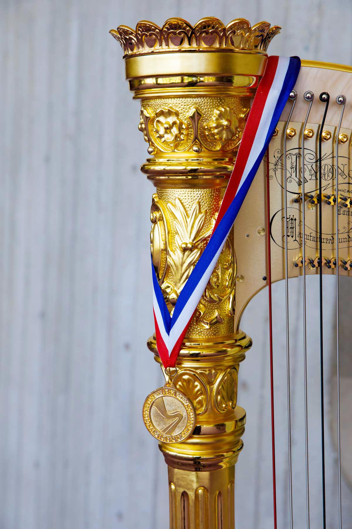 The gold medal is pictured with the Lyon and Healy Concert Grand Harp during the 11th USA International Harp Competition at Indiana University in Bloomington, Indiana on Saturday, July 13, 2019. (Photo by James Brosher)