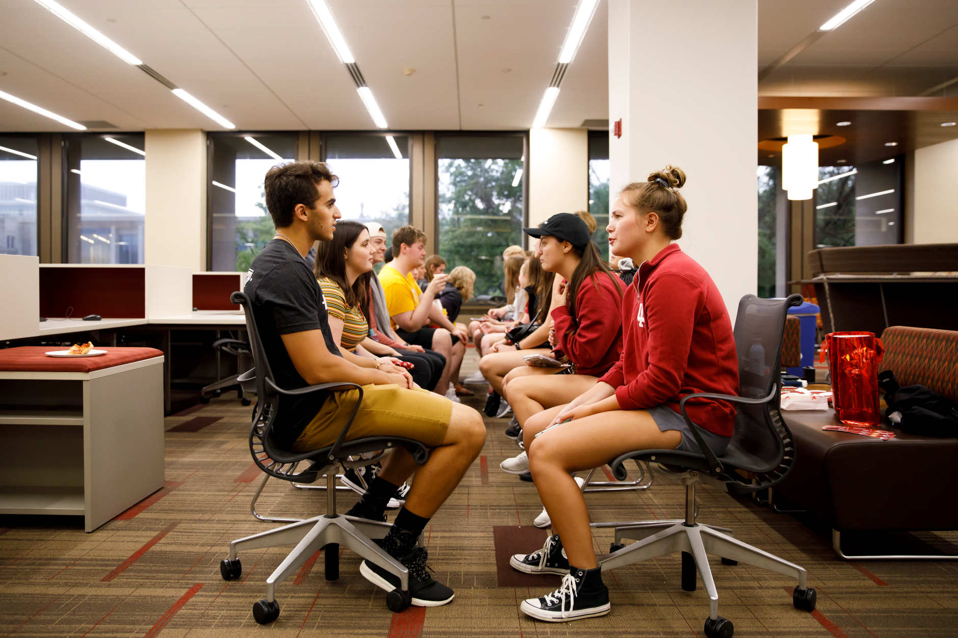 """Students participate in """"speed friending"""" during the Herman B House Party in the Wells Library at IU Bloomington on Thursday, Aug. 22, 2019. (James Brosher/Indiana University)"""