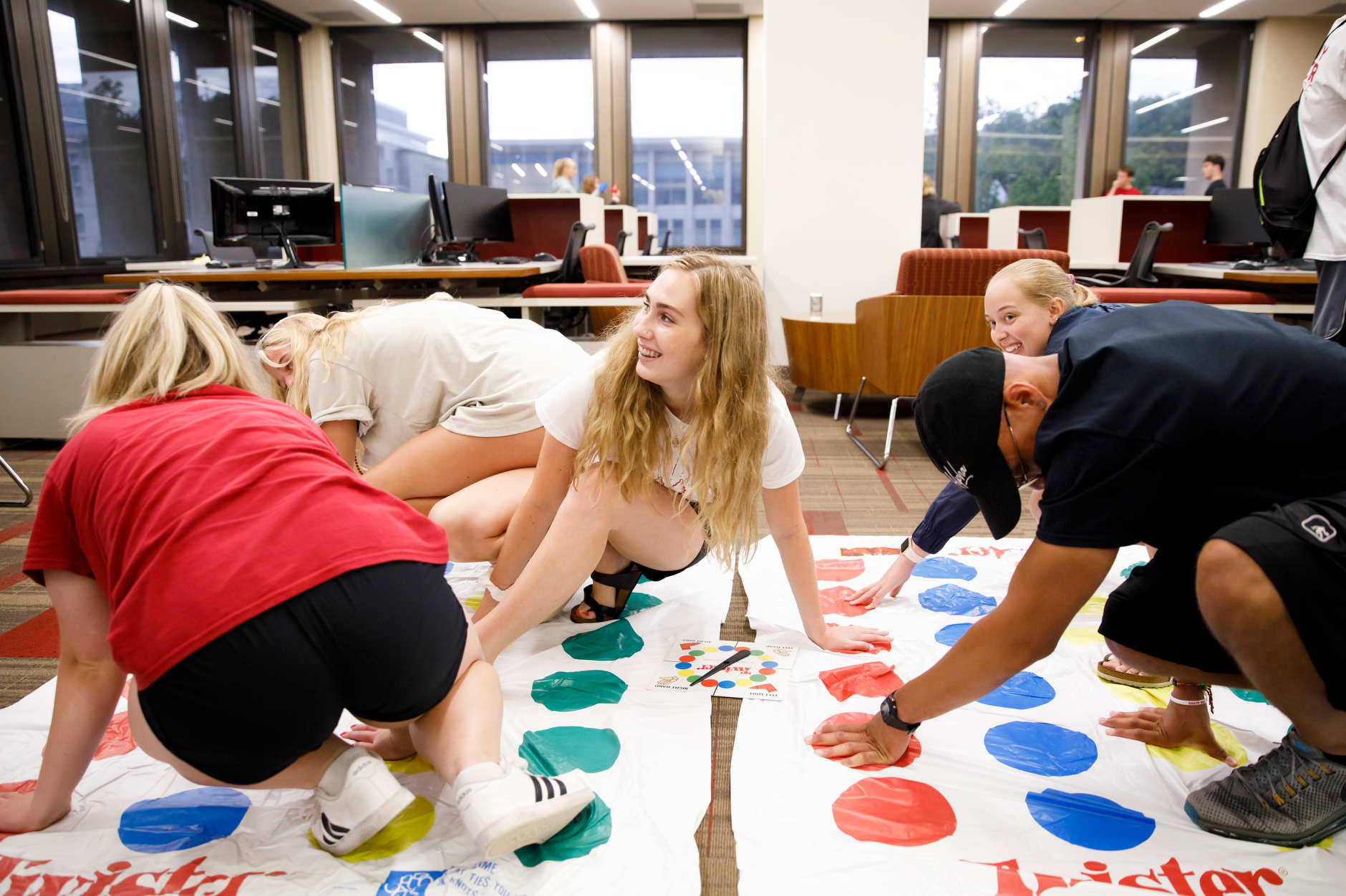Students play a game of Twister during the Herman B House Party in the Wells Library at IU Bloomington on Thursday, Aug. 22, 2019. (James Brosher/Indiana University)