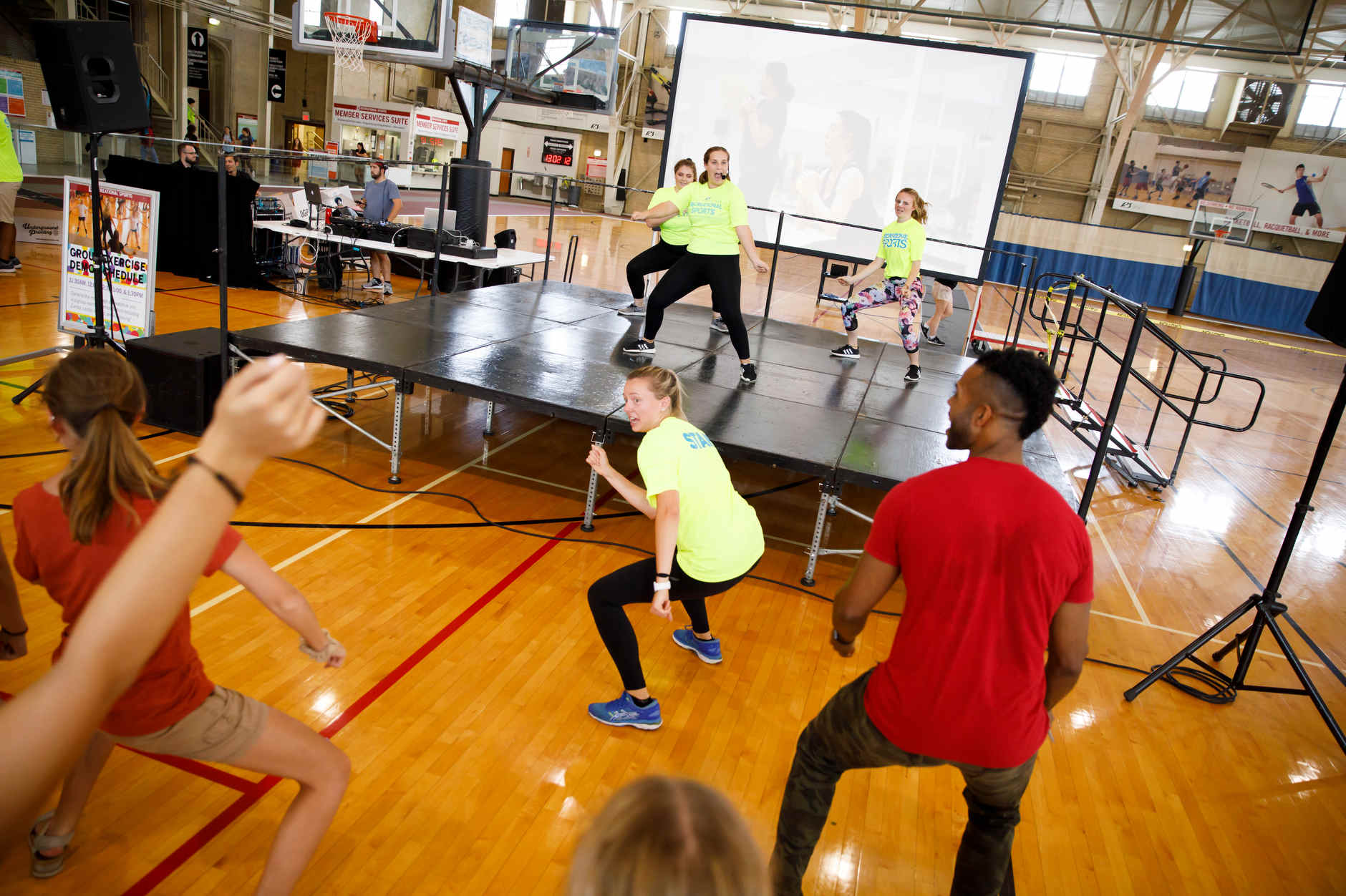 Instructors lead an exercise class from the stage RecFest in the Intramural Center at IU Bloomington on Friday, Aug. 23, 2019. (James Brosher/Indiana University)