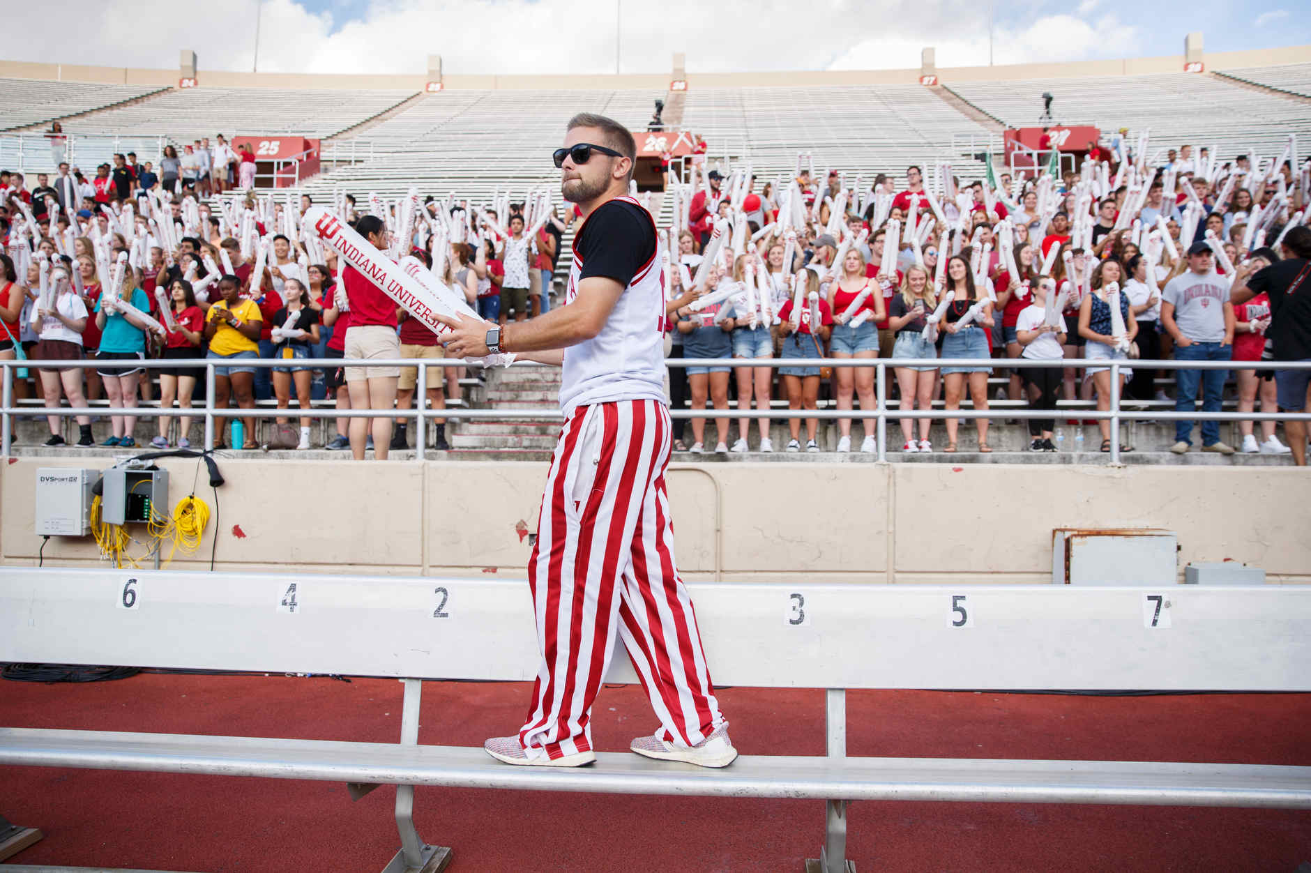 Indiana University Orientation Team member Kyle Parry pumps up the crowd during the Traditions and Spirit of IU at Memorial Stadium on Friday, Aug. 23, 2019. (James Brosher/Indiana University)