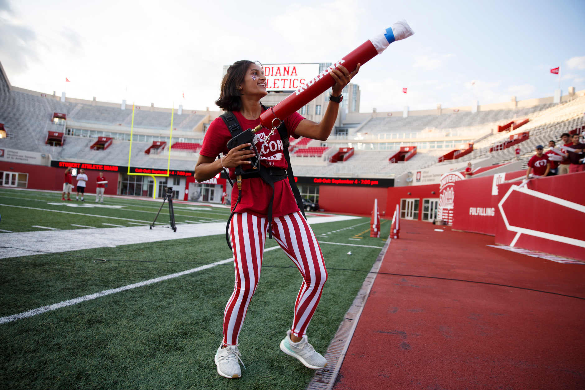 Indiana University Orientation Team member Jaanvi Bisariya shoots a t-shirt into the crowd during the Traditions and Spirit of IU at Memorial Stadium on Friday, Aug. 23, 2019. (James Brosher/Indiana University)