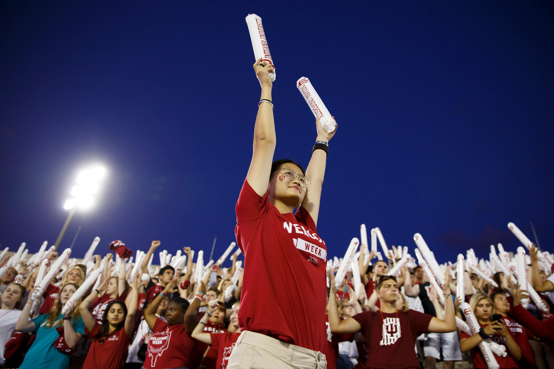 Indiana University Orientation Team member Kindjal Yu pumps up the crowd during the Traditions and Spirit of IU at Memorial Stadium on Friday, Aug. 23, 2019. (James Brosher/Indiana University)