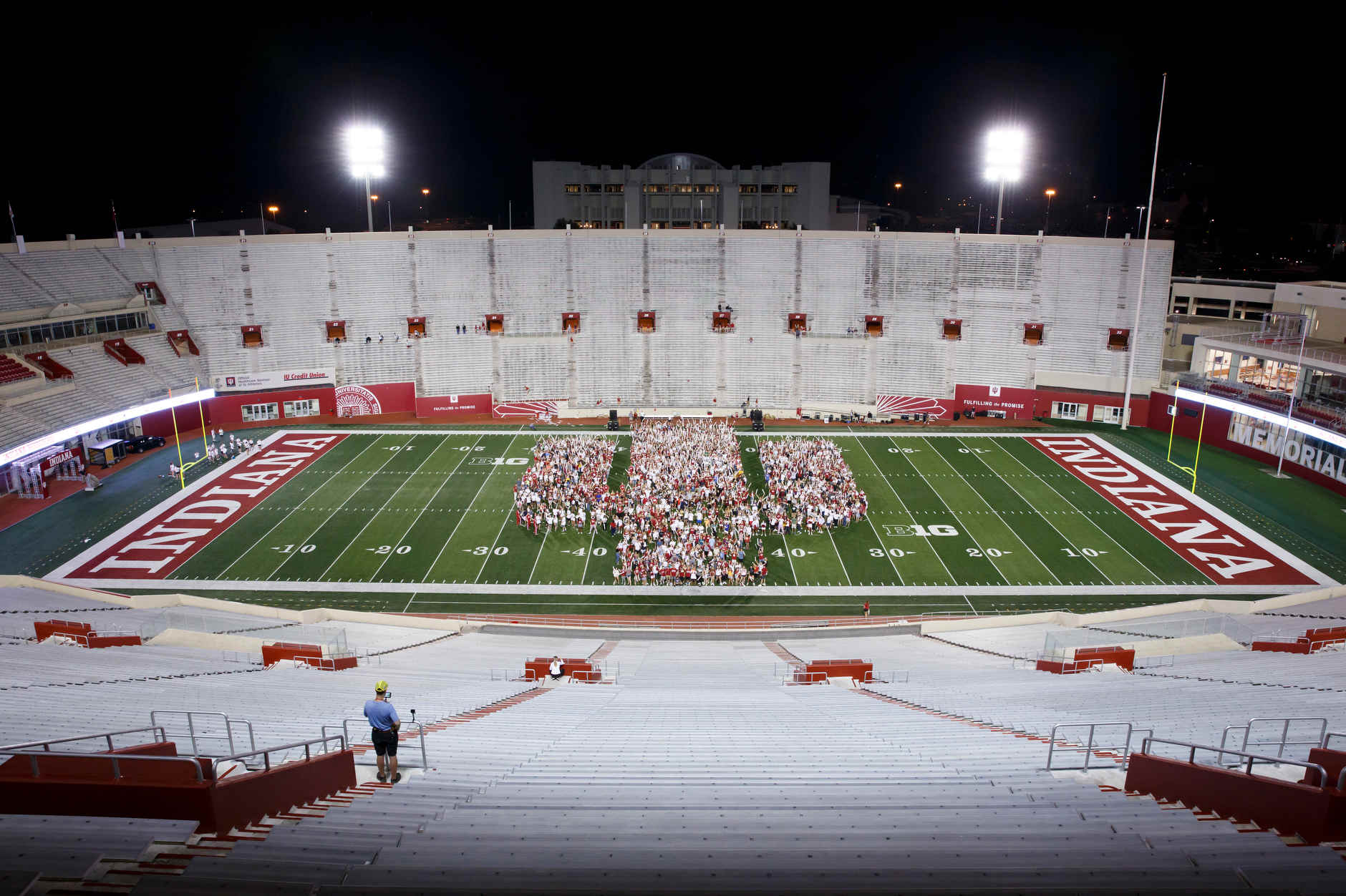 Members of the IU Class of 2023 pose for a class photo on the field during the Traditions and Spirit of IU at Memorial Stadium on Friday, Aug. 23, 2019. (James Brosher/Indiana University)