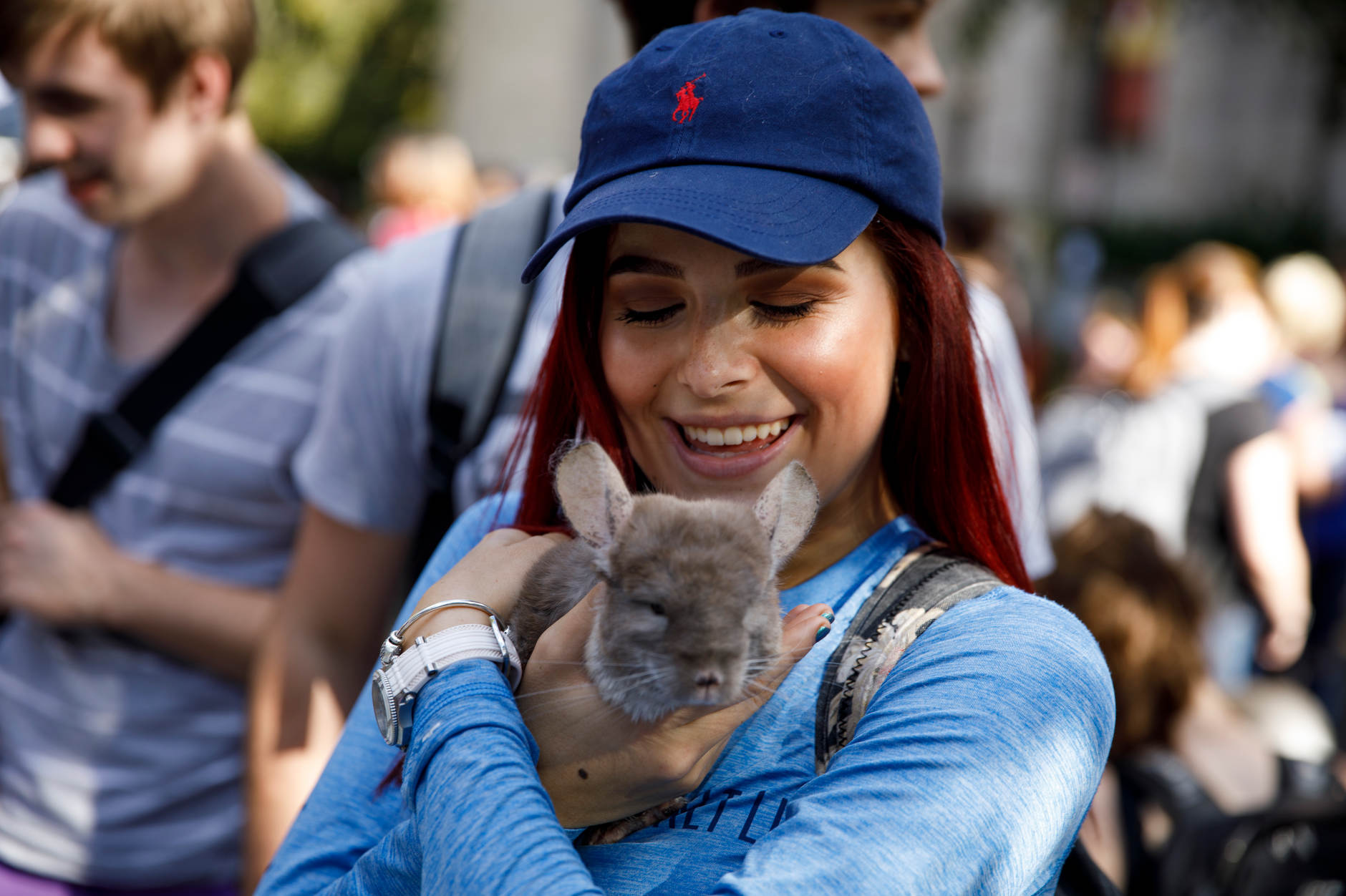 Indiana University freshman Erika Kalamaros holds Ollie, a chinchilla from Zoo'Opolis Exotic Petting Zoo, during the First Thursdays Festival on the Arts Plaza at IU Bloomington on Thursday, Sept. 5, 2019. (James Brosher/Indiana University)