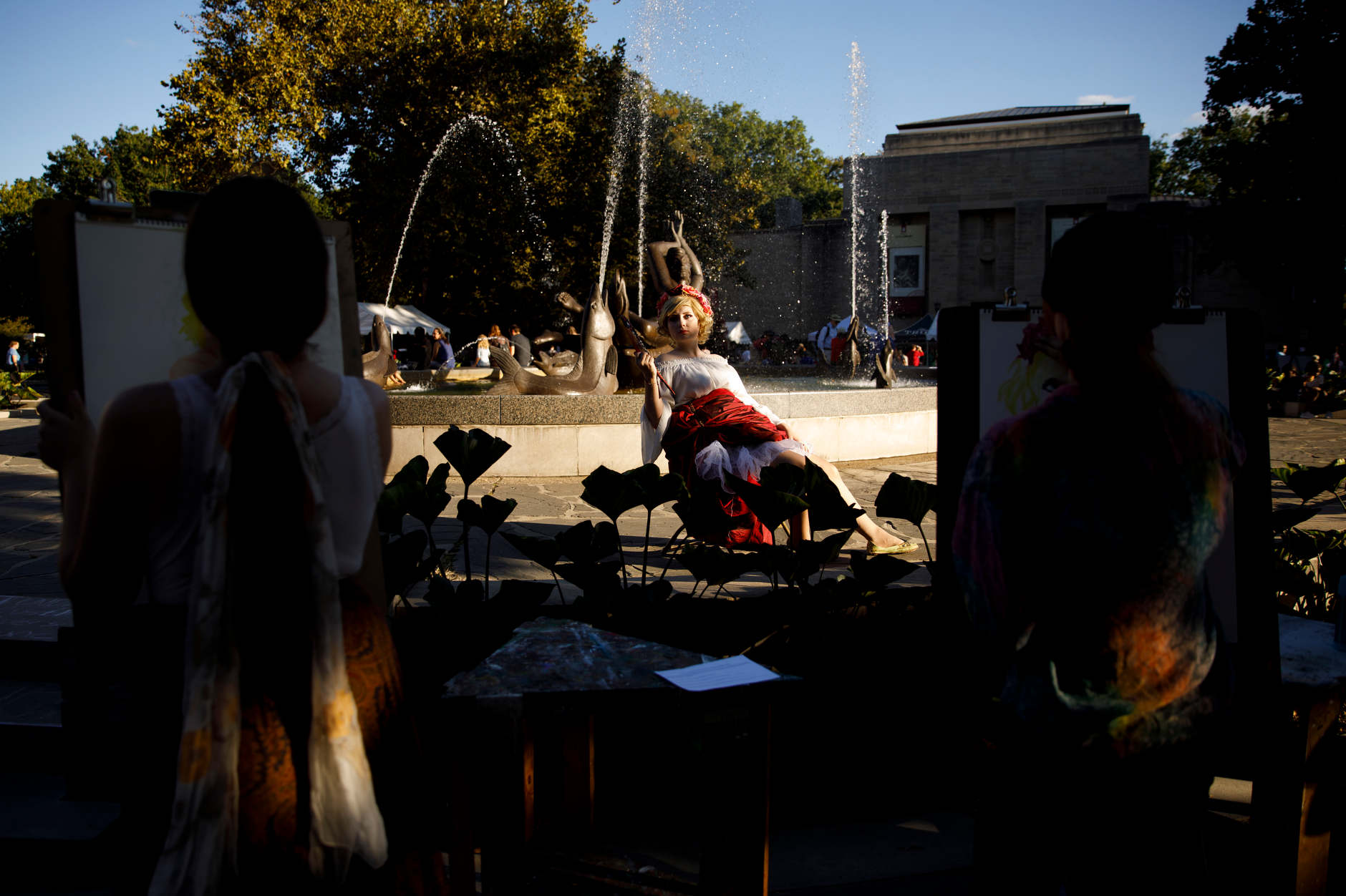 A model poses for artists near Showalter Fountain during the First Thursdays Festival on the Arts Plaza at IU Bloomington on Thursday, Sept. 5, 2019. (James Brosher/Indiana University)