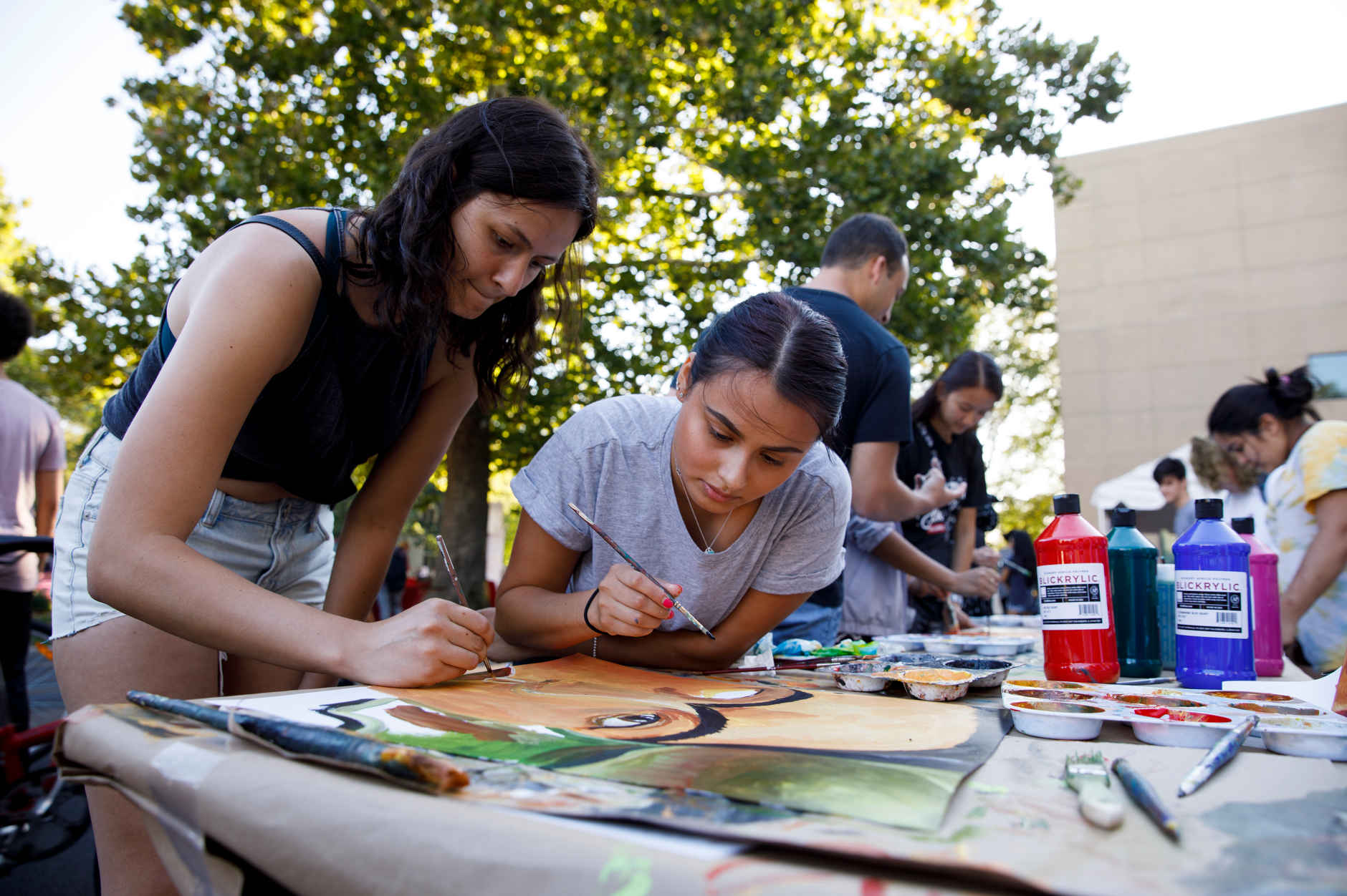 Indiana University senior Rhianna Ladd, left, and junior Brianny Alvarado paint during the First Thursdays Festival on the Arts Plaza at IU Bloomington on Thursday, Sept. 5, 2019. (James Brosher/Indiana University)