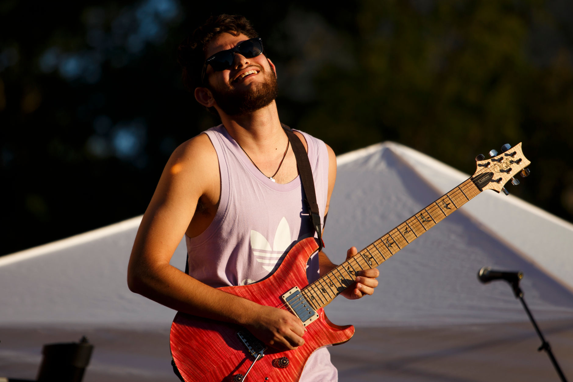 Alex Goldblatt plays guitar during a performance with Royalty - Prince Tribute Band during the First Thursdays Festival on the Arts Plaza at IU Bloomington on Thursday, Sept. 5, 2019. (James Brosher/Indiana University)