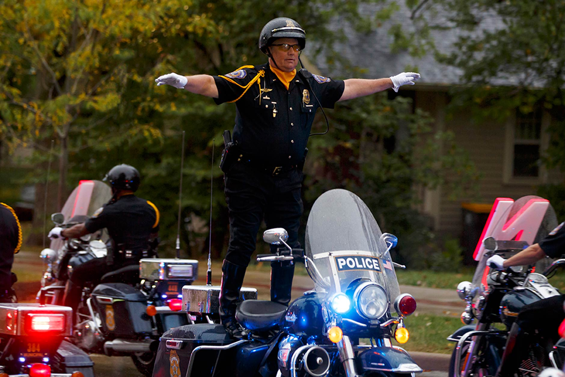 A member of the Indianapolis Metropolitan Police Motorcycle Drill Team performs during the Indiana University Bloomington Homecoming Parade on Friday, Oct. 11, 2019. (James Brosher/Indiana University)