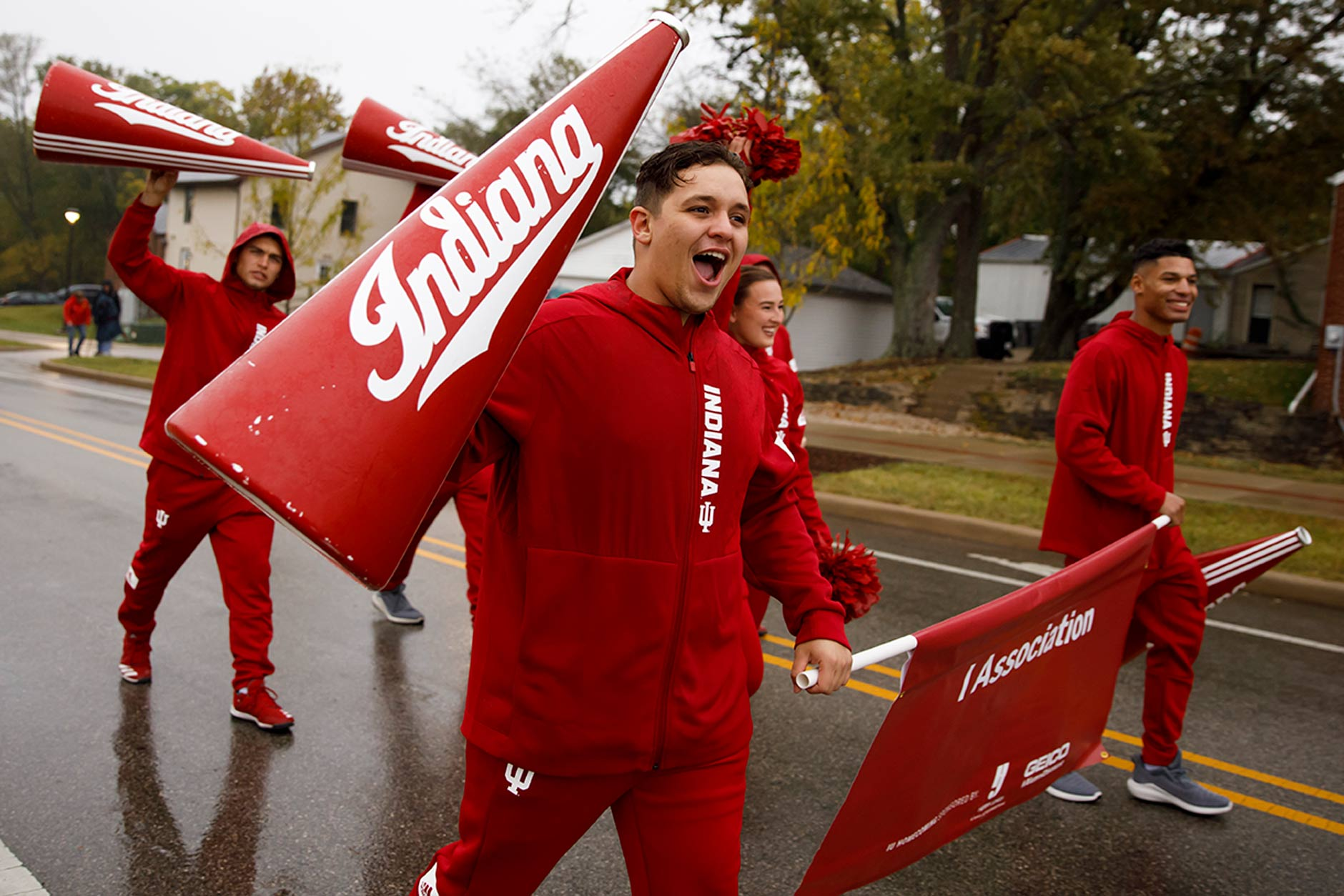 Indiana University cheerleaders walk in the IU Bloomington Homecoming Parade on Friday, Oct. 11, 2019. (James Brosher/Indiana University)