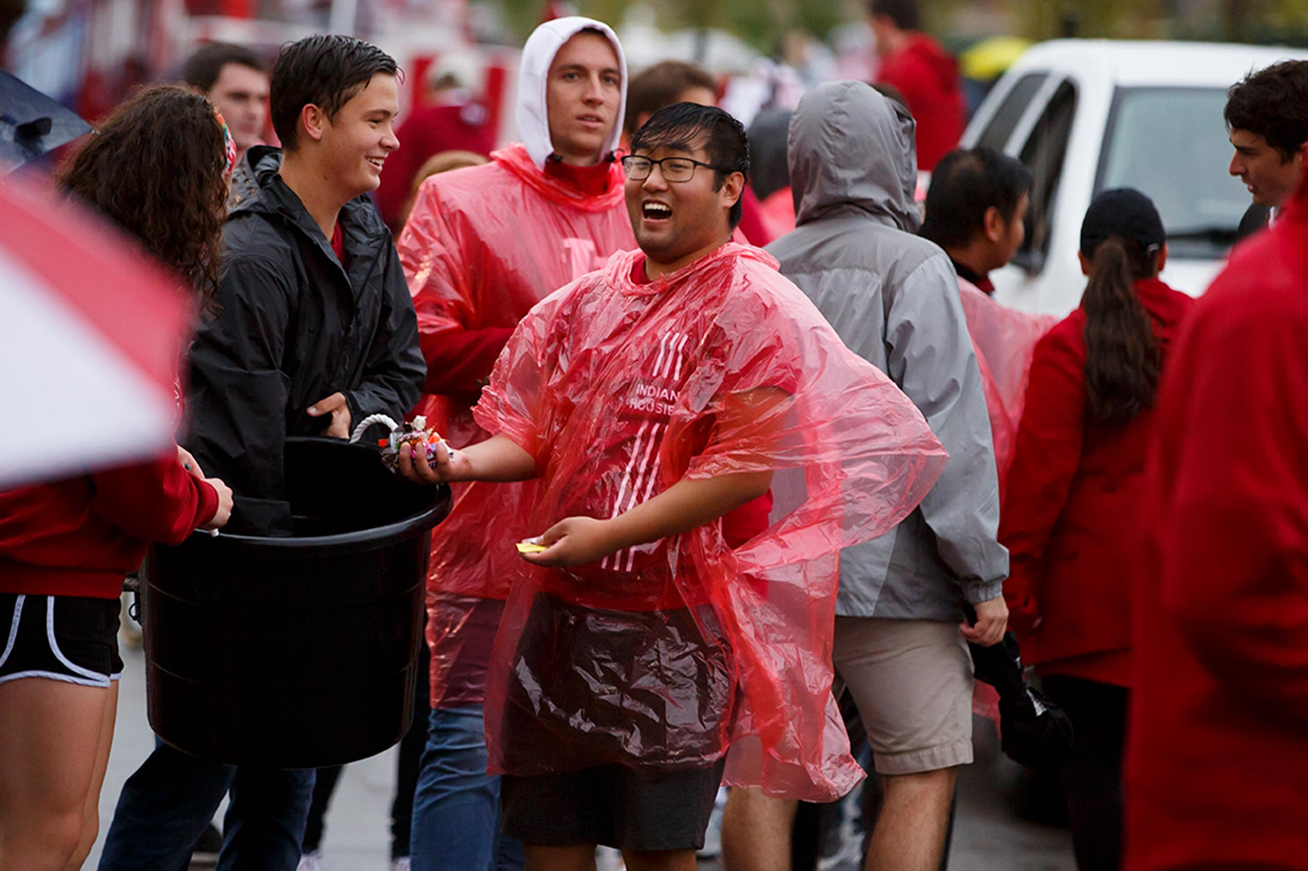 Students hand out candy along the route during the Indiana University Bloomington Homecoming Parade on Friday, Oct. 11, 2019. (James Brosher/Indiana University)