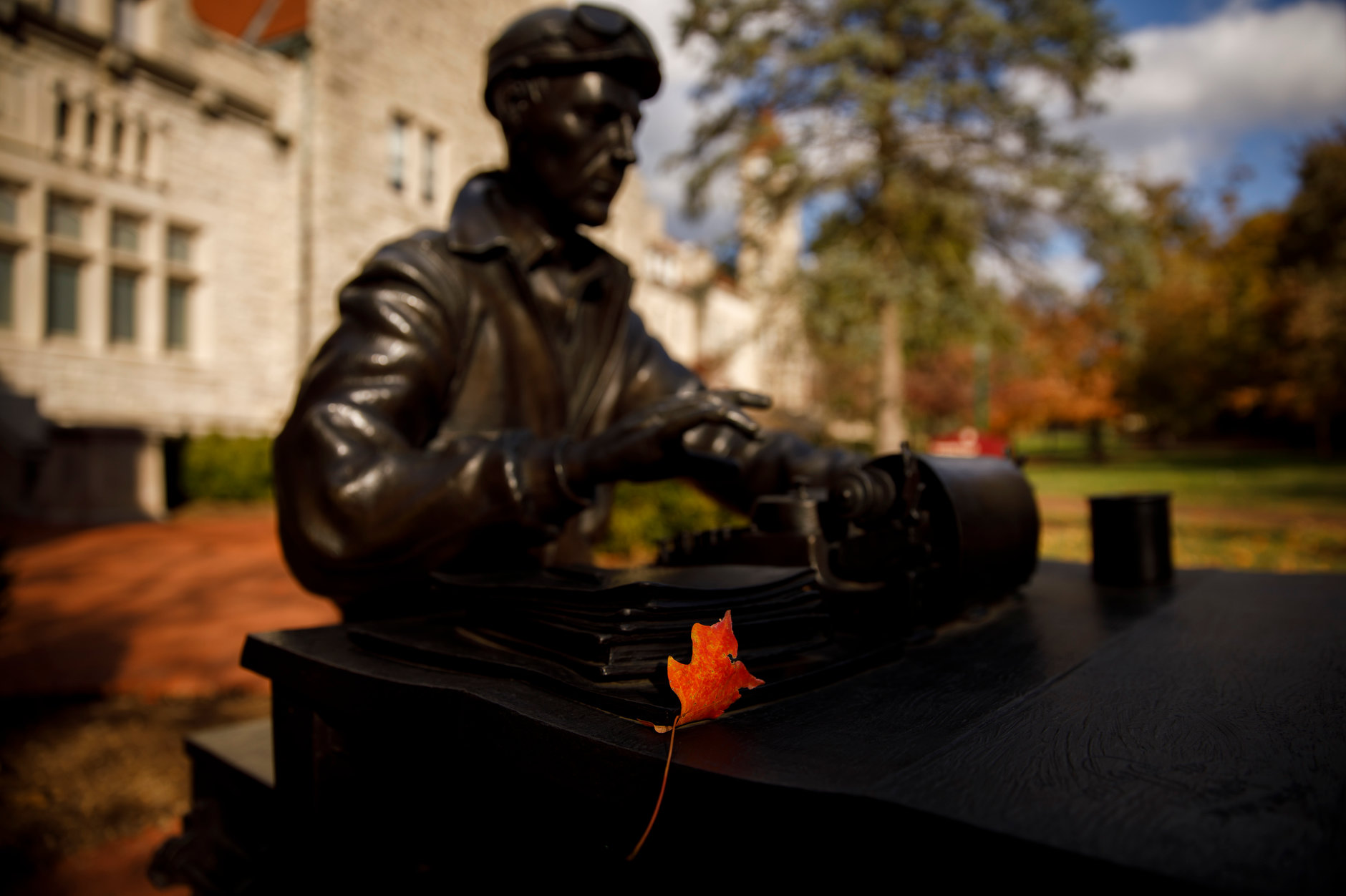 A leaf sits on a sculpture of famed WWII correspondent Ernie Pyle outside Franklin Hall on a fall day at IU Bloomington on Tuesday, Oct. 22, 2019. (James Brosher/Indiana University)