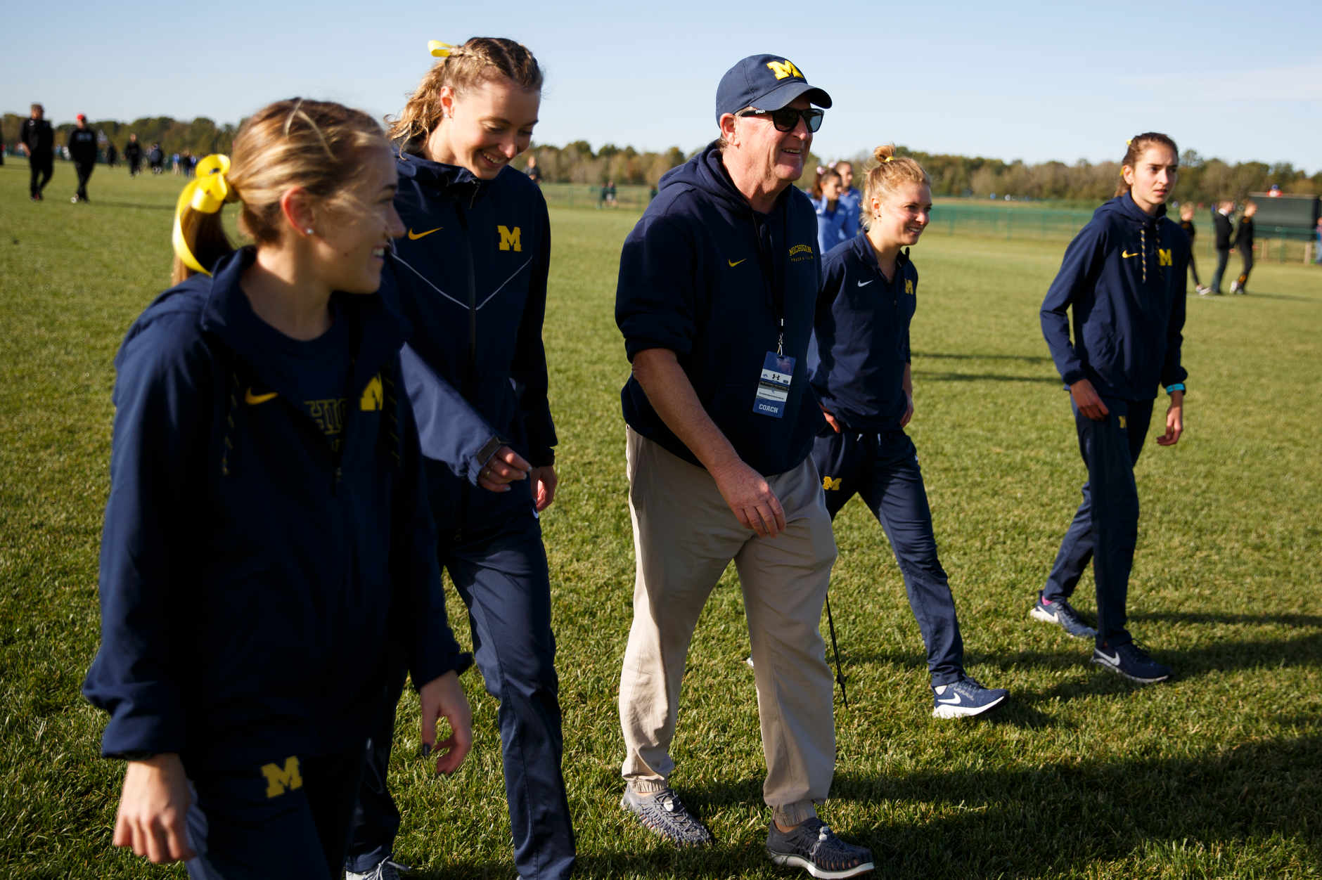 Michigan Head Coach Mike McGuire speaks with runners before the Indiana State Pre-National Cross Country Invitational in Terre Haute, Indiana on Saturday, Oct. 19, 2019. (Photo by James Brosher)