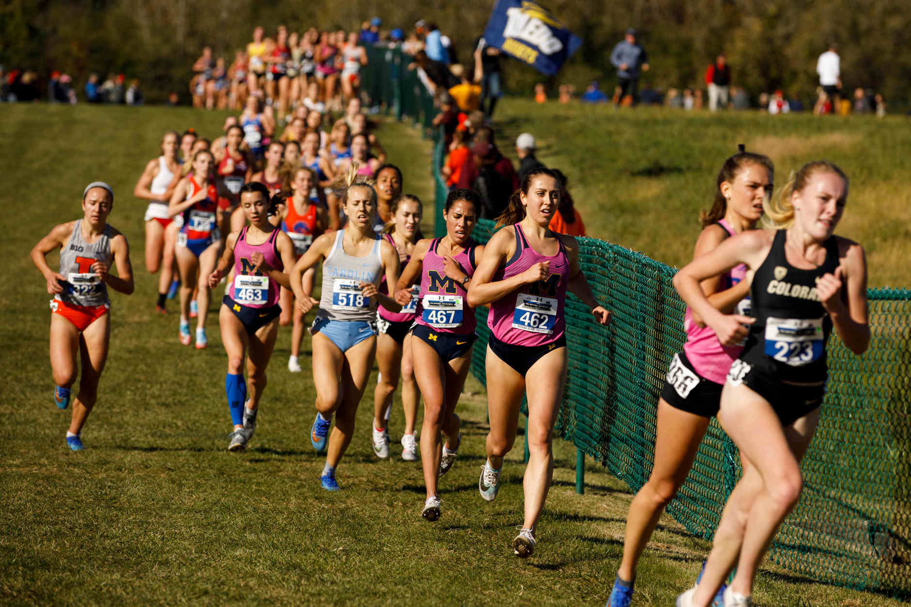 Michigan's Camille Davre (462), Jena Metwalli (467) and Micaela DeGenero (463) compete during the Indiana State Pre-National Cross Country Invitational in Terre Haute, Indiana on Saturday, Oct. 19, 2019. (Photo by James Brosher)