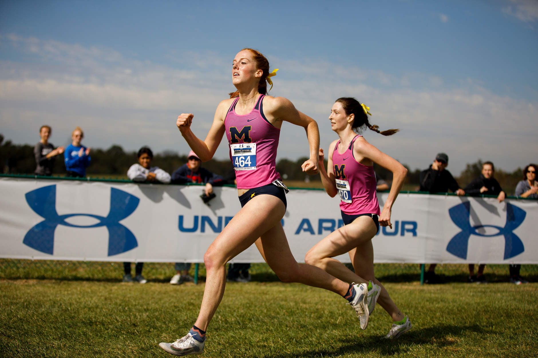 Michigan's Alice Hill (464) and Emma Sloan (470) race to the finish line during the Indiana State Pre-National Cross Country Invitational in Terre Haute, Indiana on Saturday, Oct. 19, 2019. (Photo by James Brosher)
