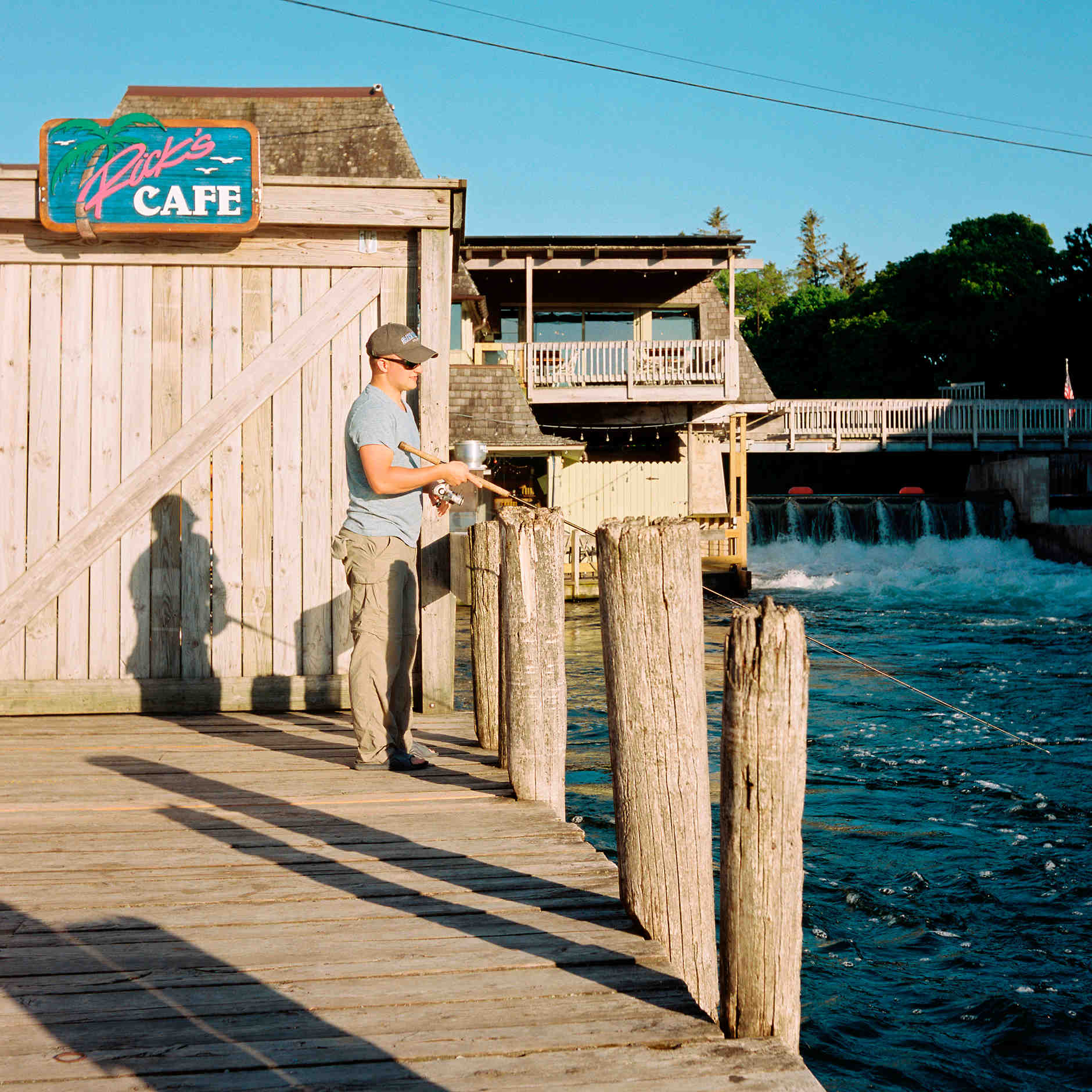 A man reels in his bait in Fishtown in Leland, Michigan on Monday, June 10, 2019. (Photo by James Brosher)