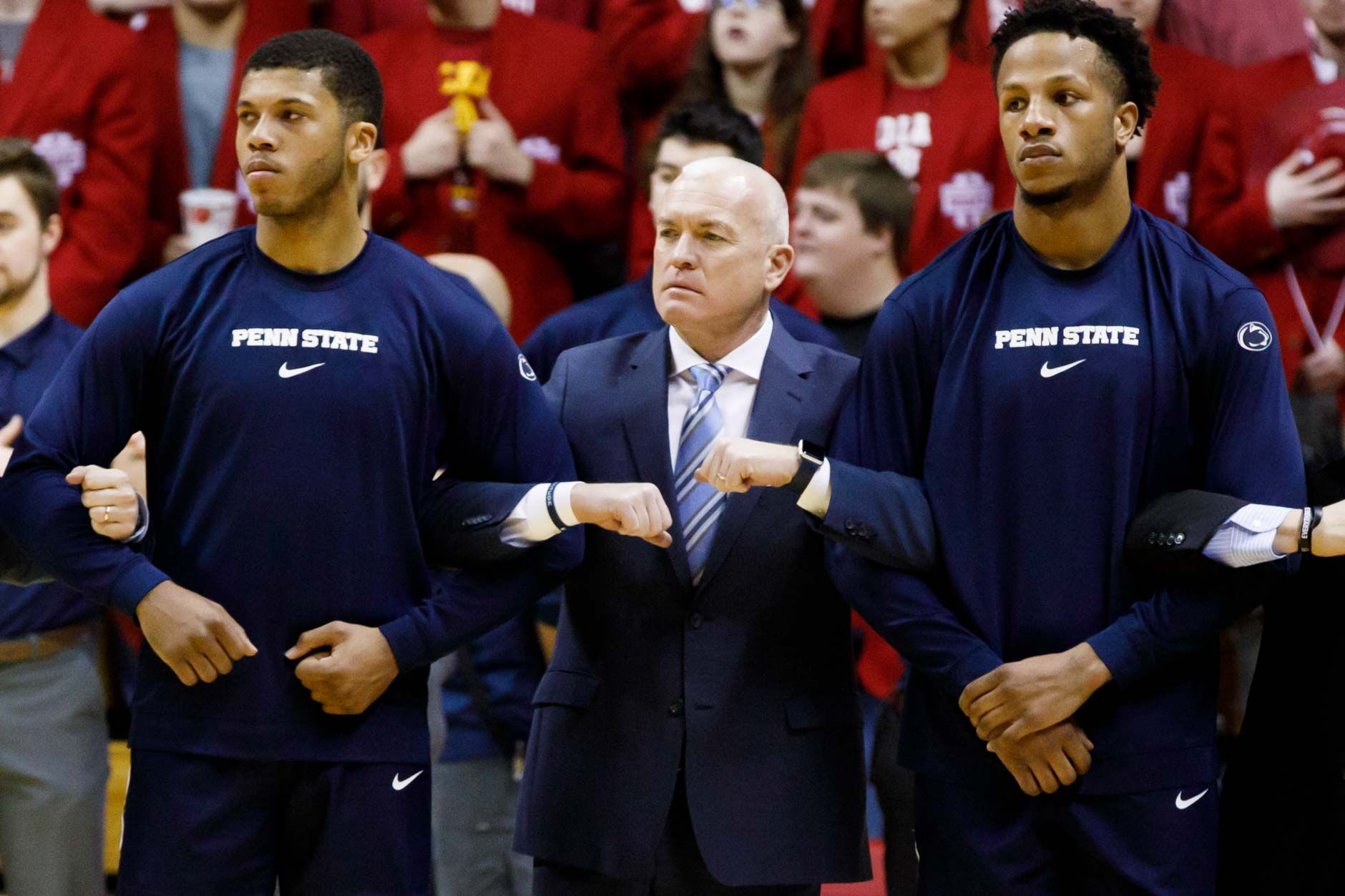Penn State Head Coach Patrick Chambers, center, locks arms with Myles Dread, left, and Lamar Stevens during the National Anthem before a NCAA men's basketball game at Simon Skjodt Assembly Hall in Bloomington, Indiana on Sunday, Feb. 23, 2020. (Photo by James Brosher)
