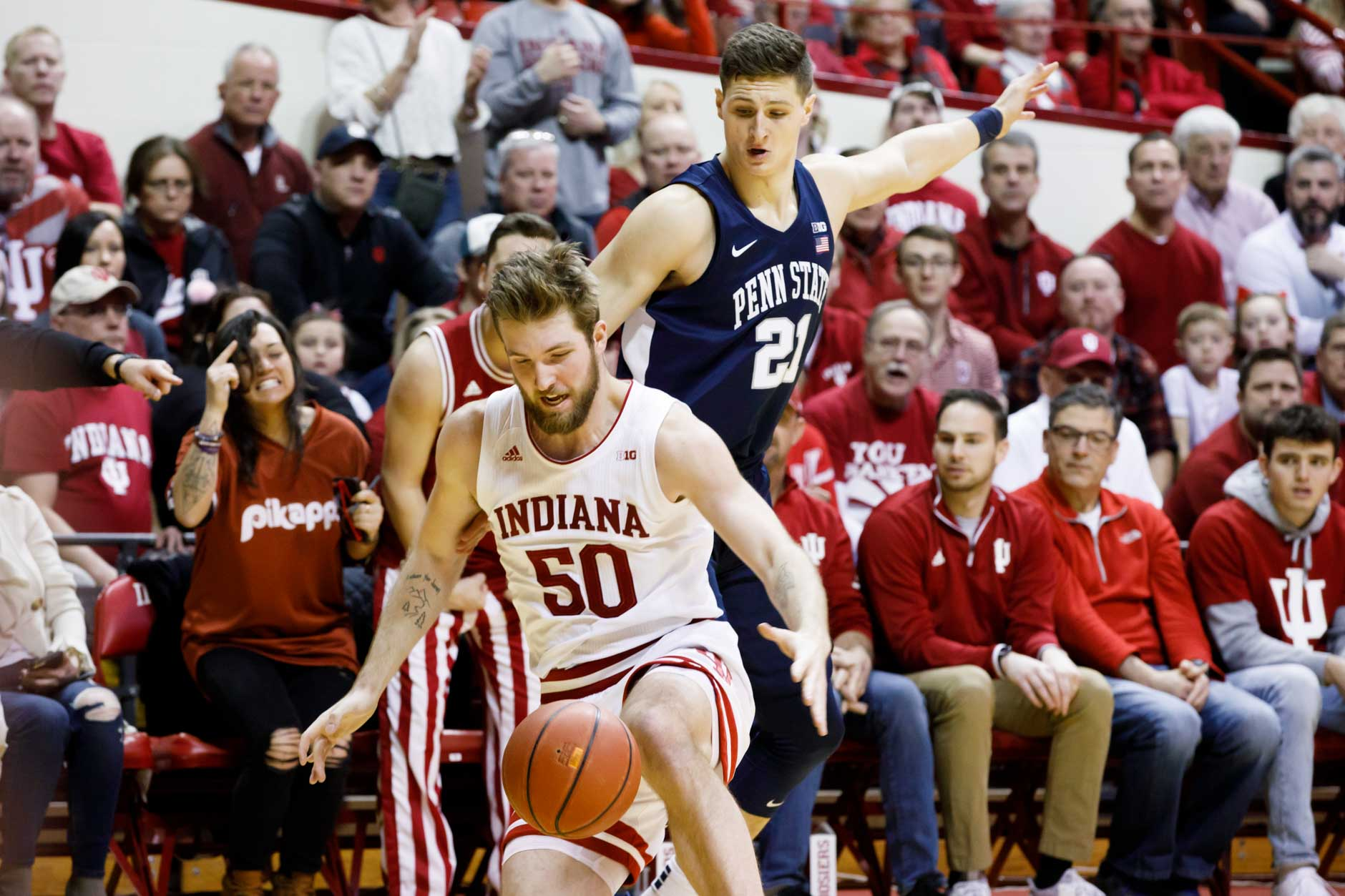 Penn State's John Harrar (21) and Indiana's Joey Brunk (50) compete for a loose ball during a NCAA men's basketball game at Simon Skjodt Assembly Hall in Bloomington, Indiana on Sunday, Feb. 23, 2020. (Photo by James Brosher)