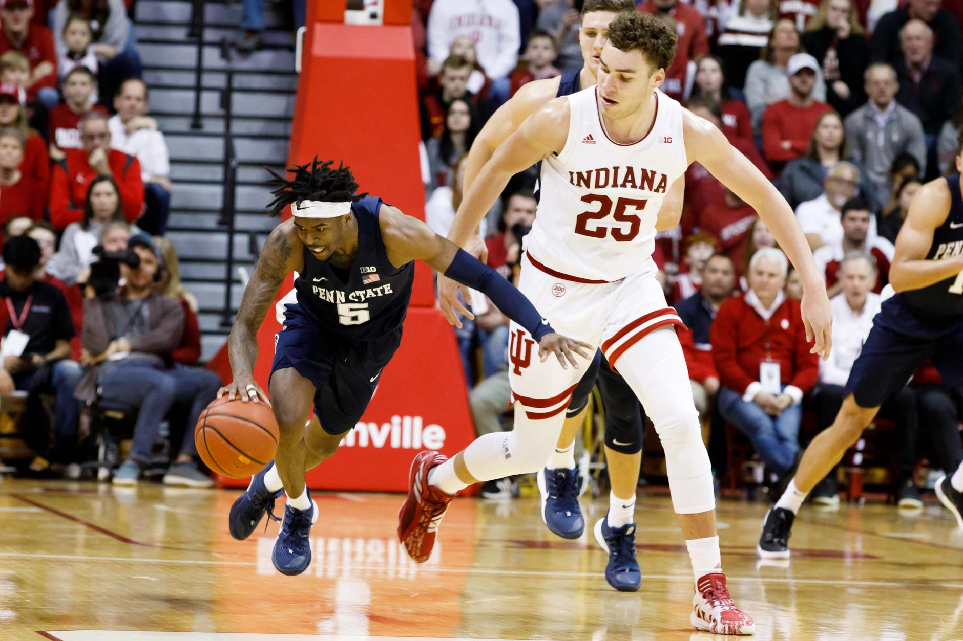 Penn State's Jamari Wheeler (5) is fouled by Indiana's Race Thompson (25) during a NCAA men's basketball game at Simon Skjodt Assembly Hall in Bloomington, Indiana on Sunday, Feb. 23, 2020. (Photo by James Brosher)