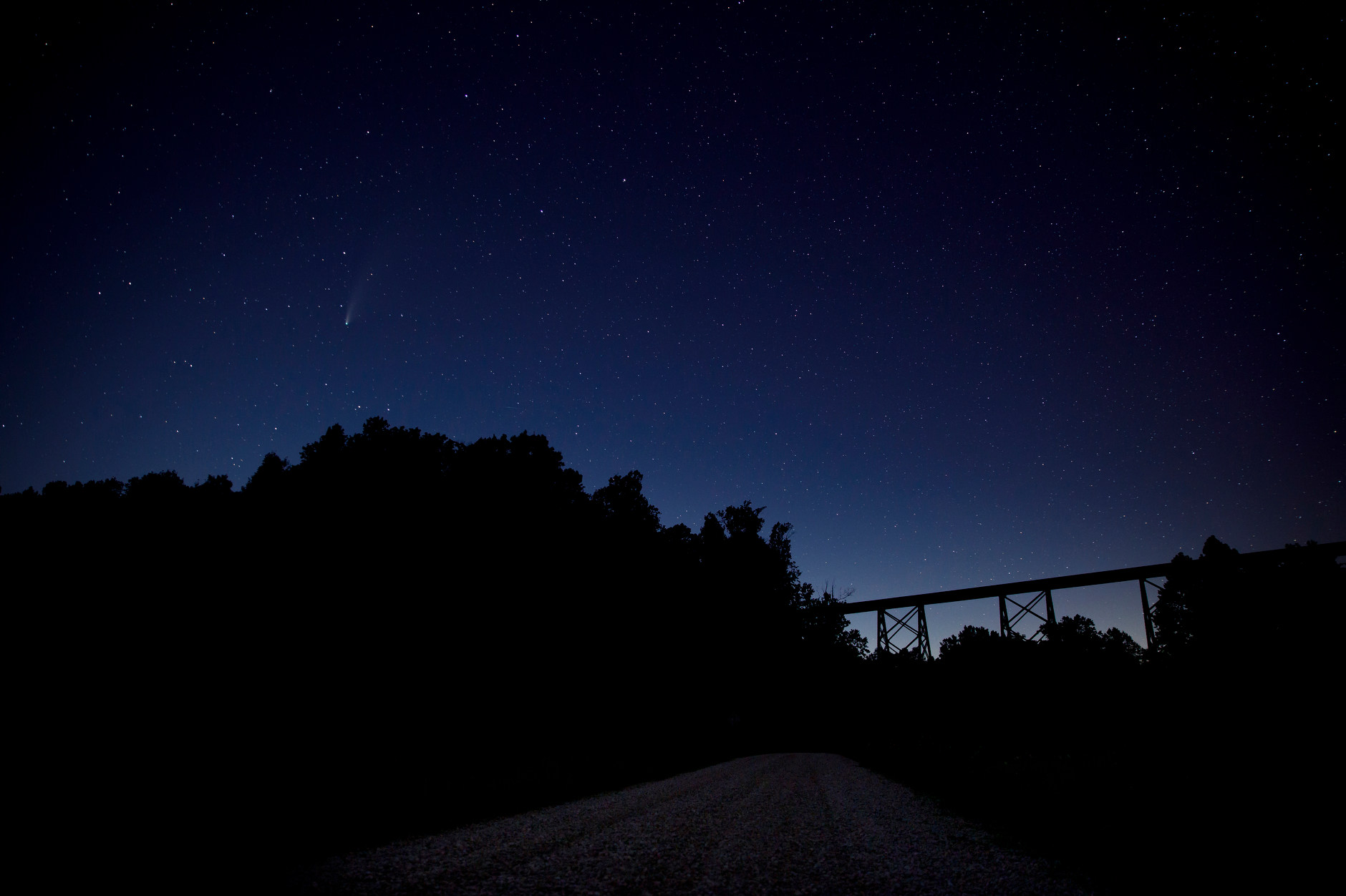 Comet NEOWISE is seen in the night sky near the Tulip Viaduct, pictured in silhouette at right, in rural Greene County, Indiana on Thursday, July 23, 2020. (Photo by James Brosher)