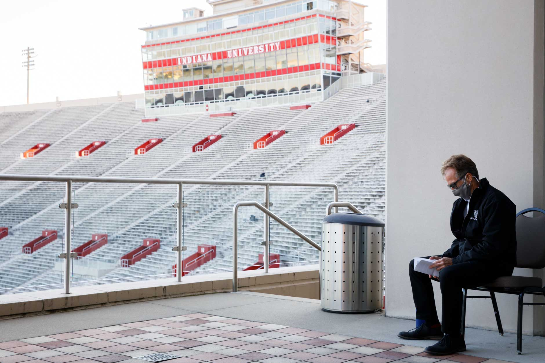 "Indiana University Cinema Director Jon Vickers looks over his notes as he waits to introduce a screening of ""Cinema Paradiso"" in Memorial Stadium at IU Bloomington on Tuesday, Sept. 29, 2020. The film screening was Vickers' final public event as IU Cinema's founding director. (James Brosher/Indiana University)"
