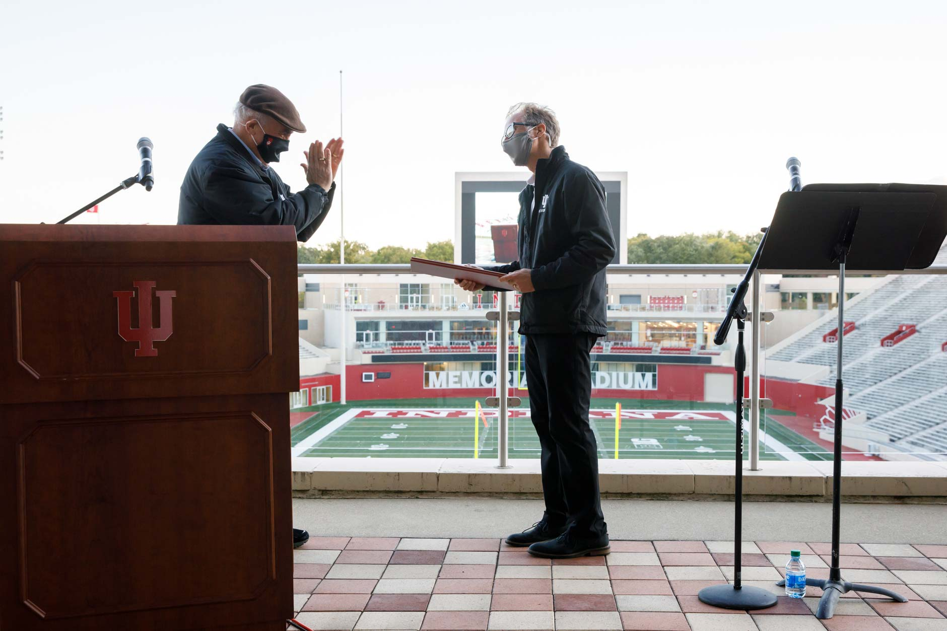 "Indiana University President Michael A. McRobbie, left, presents the President's Medal of Excellence to IU Cinema Director Jon Vickers before a screening of ""Cinema Paradiso"" in Memorial Stadium at IU Bloomington on Tuesday, Sept. 29, 2020. The film screening was Vickers' final public event as IU Cinema's founding director. (James Brosher/Indiana University)"