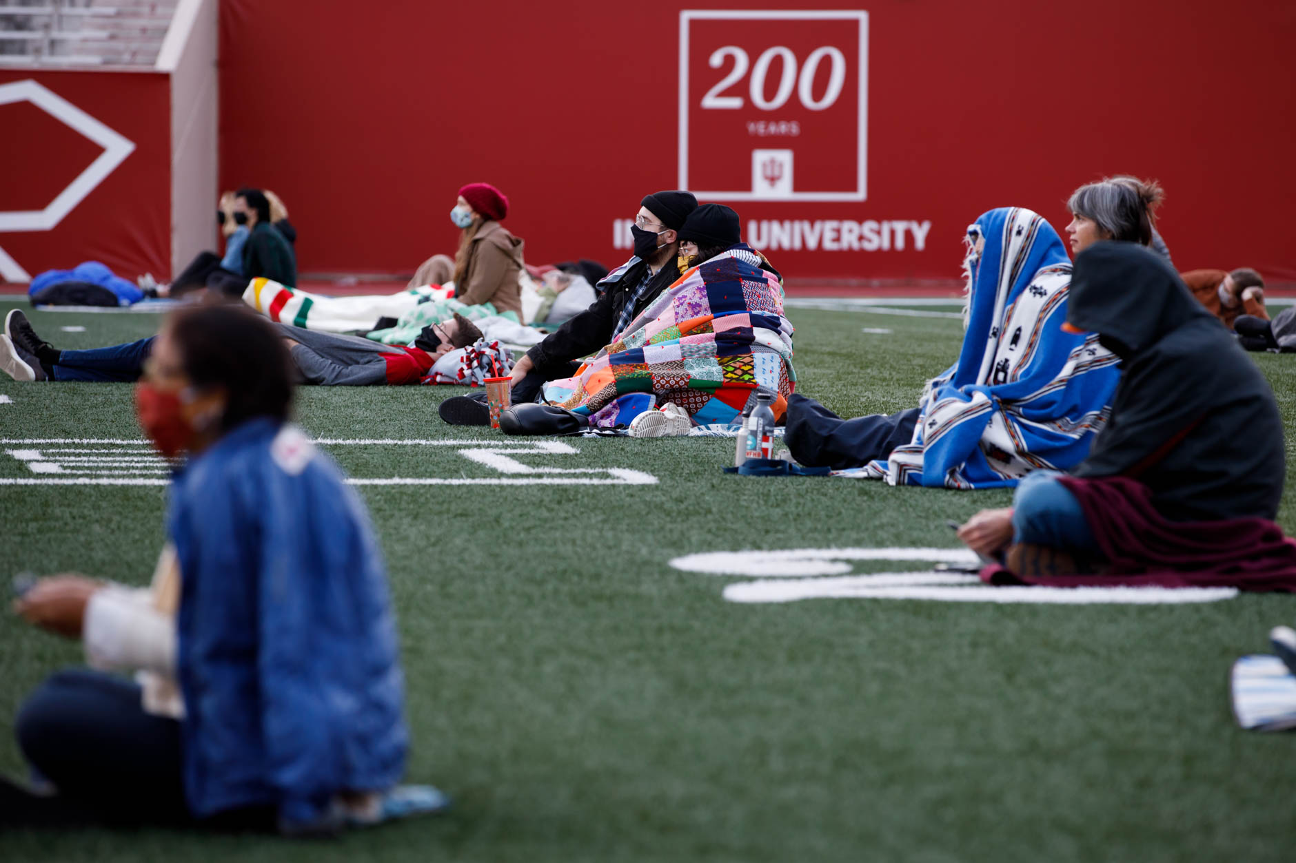 "Audience members watch a socially-distant screening of ""Cinema Paradiso"" from the field in Memorial Stadium at IU Bloomington on Tuesday, Sept. 29, 2020. (James Brosher/Indiana University)"