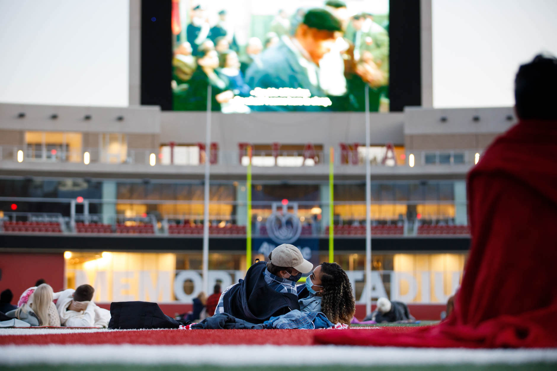"A couple embraces as they watch a screening of ""Cinema Paradiso"" from the field in Memorial Stadium at IU Bloomington on Tuesday, Sept. 29, 2020. (James Brosher/Indiana University)"
