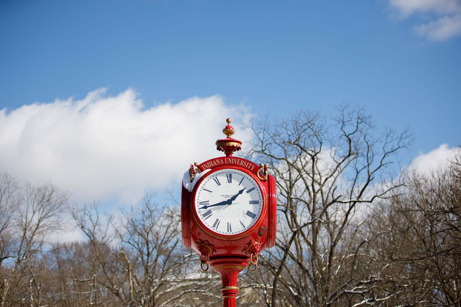 Snow adorns the top of a red clock near Woodburn Hall on a winter day at Indiana University Bloomington on Thursday, Jan. 28, 2021. (James Brosher/Indiana University)