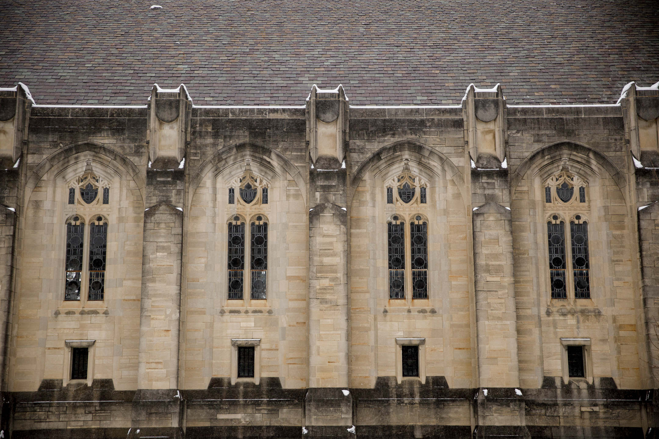 Snow clings to limestone features on the side of the Indiana Memorial Union on a winter day at Indiana University Bloomington on Wednesday, Feb. 10, 2021.