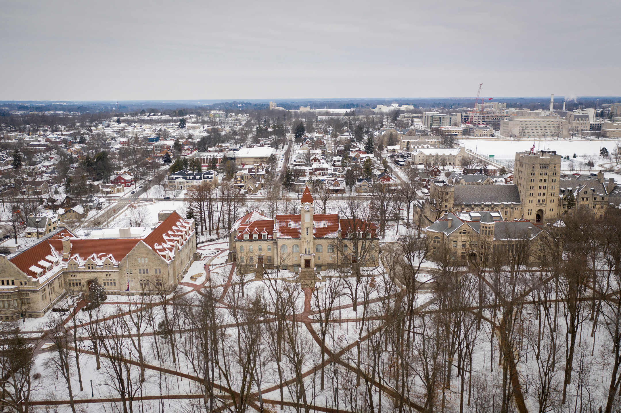 A snow-covered Old Crescent is pictured from the air at Indiana University Bloomington on Friday, Feb. 12, 2021. Pictured at center is the Student Building clock tower.